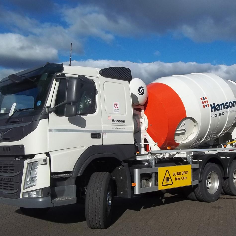 Tridem concrete mixer truck.